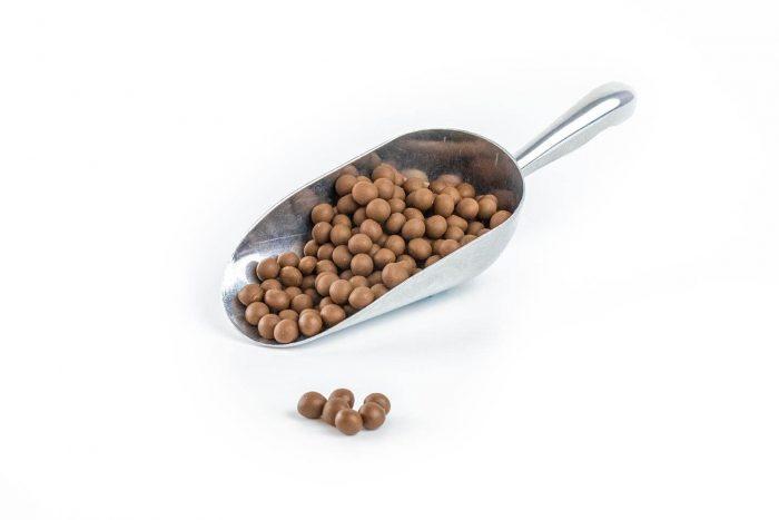 3020 - Milk Choc Fudge Ball in a stainless steel scoop