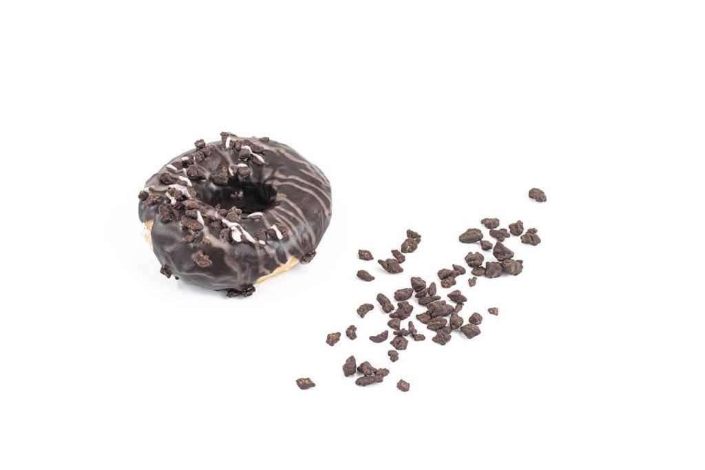 Dark Chocolate Peppermint Kibble on donut with product on white background