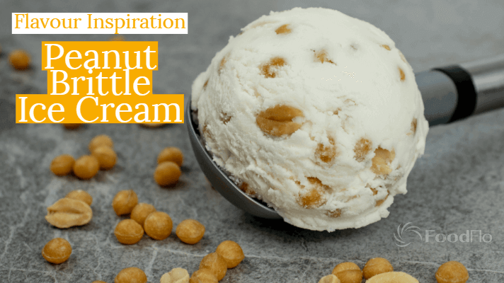 Image of ice peanut brittle ice cream on scoop with brittle balls (3118) and roasted peanuts on grey base