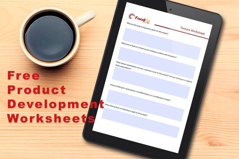 Free Product Development Worksheets - header image with tablet showing interactive worksheets on wood table with a cup of coffee